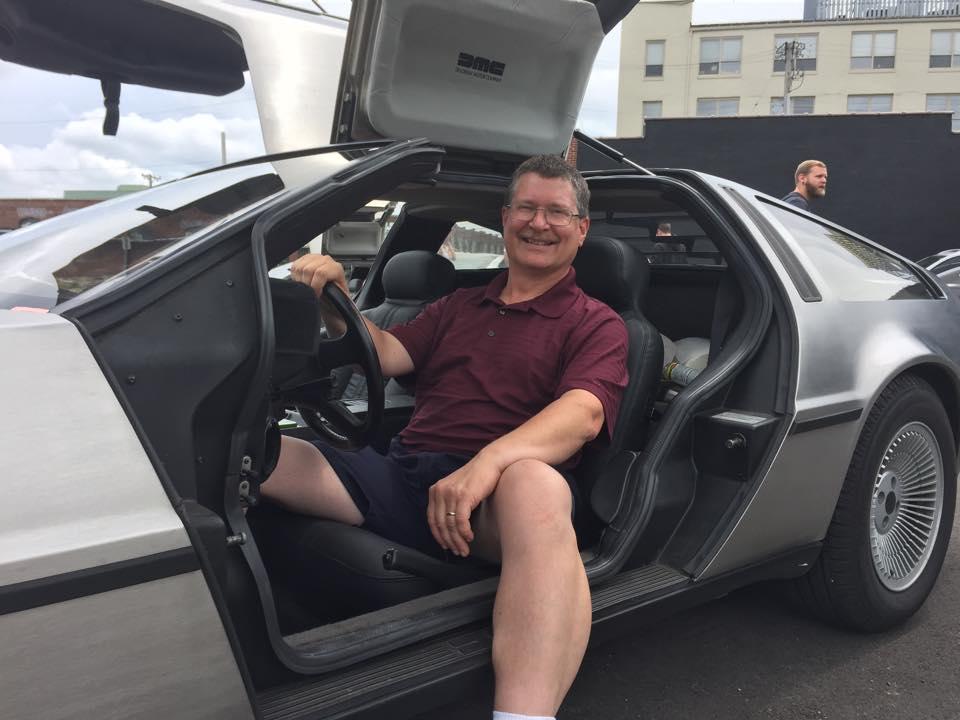 Doug Menkaus in his restored DeLorean DMC-12