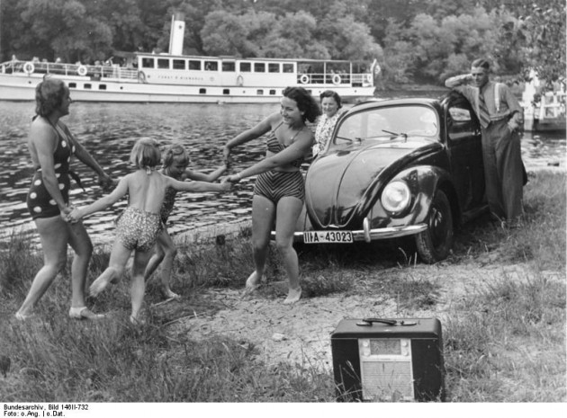 """Volkswagen KdF Propaganda: """"A family playing by a river with a KdF-Wagen and radio receiver"""""""