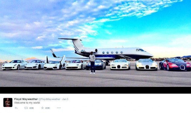 Mayweather poses in front of his personal jet and eight exotic vehicles.