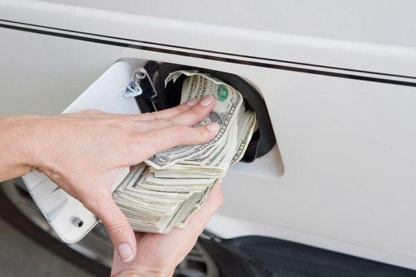 Money cash into gas tank Premium gasoline benefits