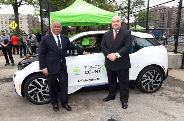 NYC Parks Commissioner Mitchell J. Silver, on left, and BMW's Manuel Sattig with one of the 20 BMW i3 electric vehicles donated to NYC Parks in support of the TreesCount! census during a press conference at Julio Carballo Fields on Tuesday, May 19, 2015 in the Bronx Borough of New York. (Photo by Scott Gries/Invision for BMW of North America/AP Images)