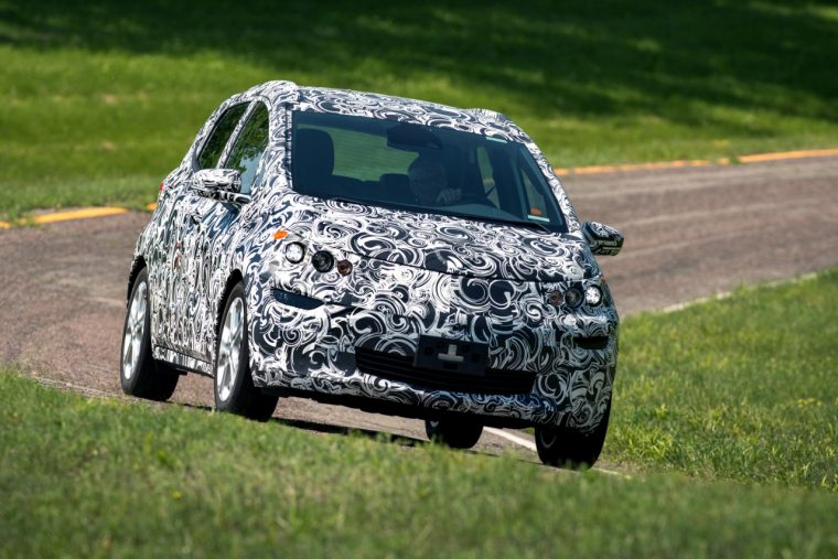 A camouflaged Chevy Bolt EV undergoes testing at GM's proving grounds in Milford, Michigan