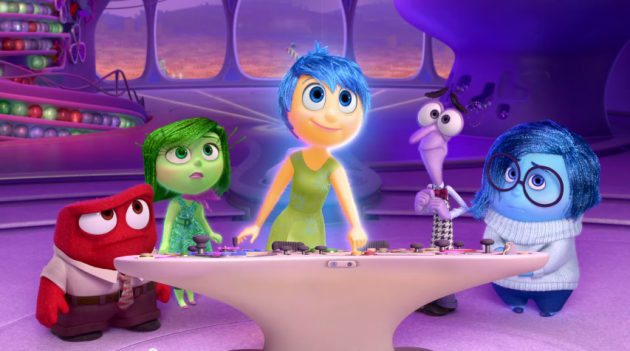"The <i>Inside Out</i> team at the console</br> <em><sub>Photo:<a href=""http://movies.disney.com/inside-out/"">Disney•Pixar</a></sub></em>"