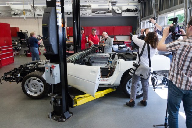 GM technicians work to restore the badly damaged 1992 C4 Corvette convertible