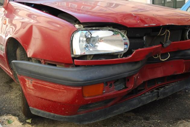 crashed red car front