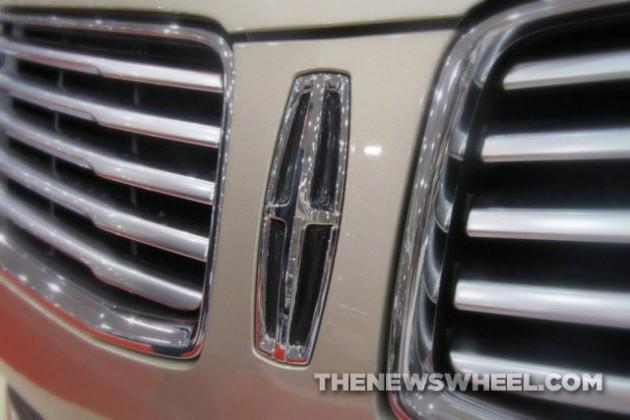 Lincoln-logo-badge-emblem-cross-meaning