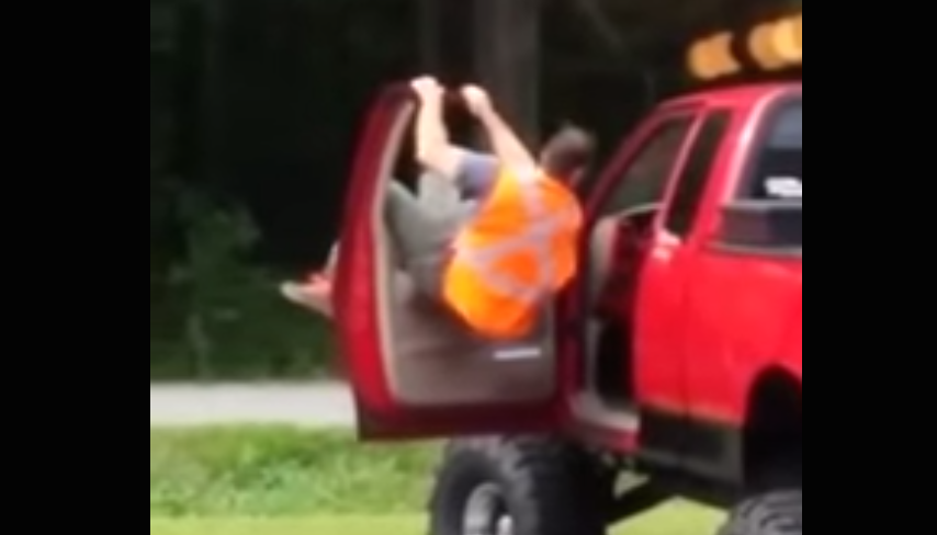 drunk guy tries to climb from bed of truck to cab video