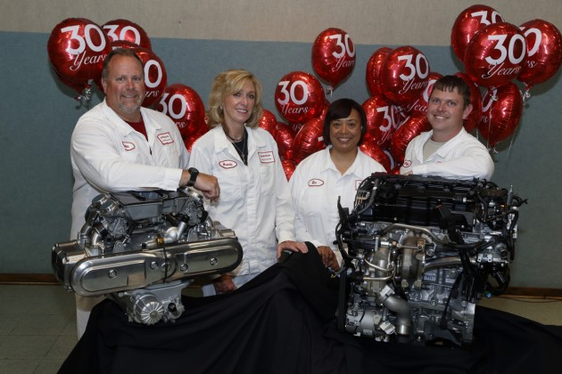 Honda Anna Engine Plant associates pose with the plant's first GL1200 engine (left) and the new turbo engine
