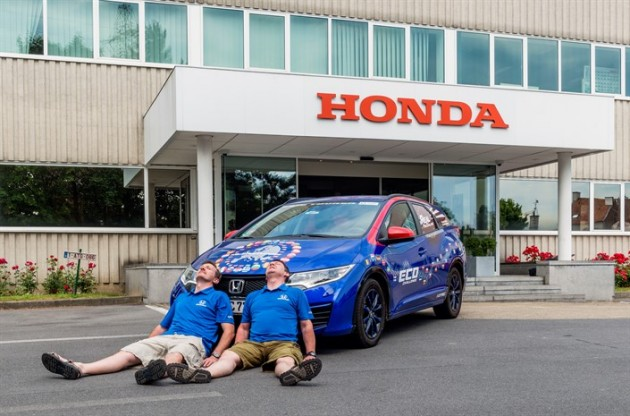 Honda R&D employees Fergal McGrath and Julian Warren take a well-deserved rest after their record-breaking 8,000-mile journey