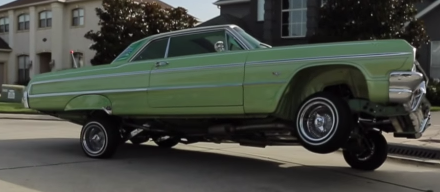 New Orleans Rapper Curreny Shows Off His Custom Painted 64 Chevy Impala Lowrider