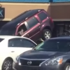 [VIDEO] Florida Man Unsuccessfully Attempts to Drive SUV Off of Tow Truck
