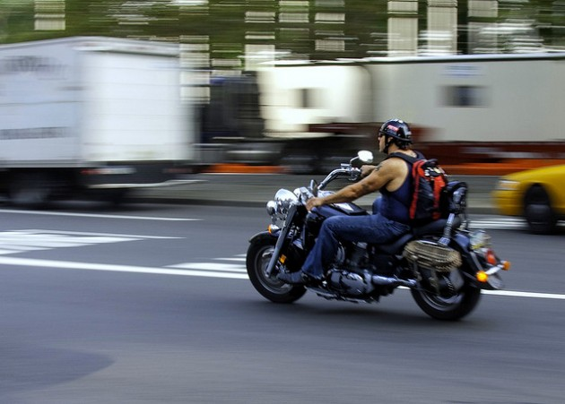 Man on motorcycle driver riding