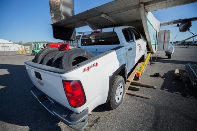 2015 Chevy Colorado pickup truck being loaded onto airplane in Alaska