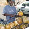 coconut seller with machete