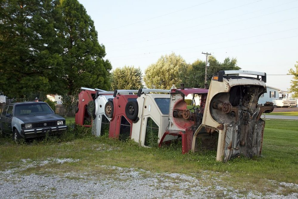 Cars buried in the ground on Route 66 at Henry's Rabbit Ranch in Staunton, Illinois