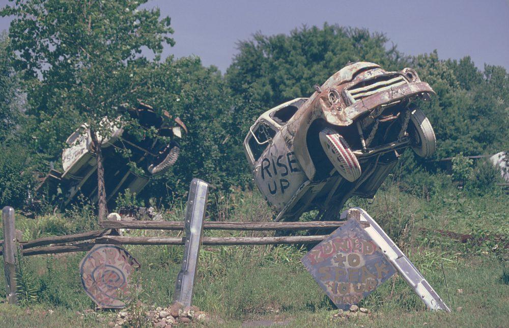 Trucks sticking out of the ground at Truckhenge near Topeka, Kansas