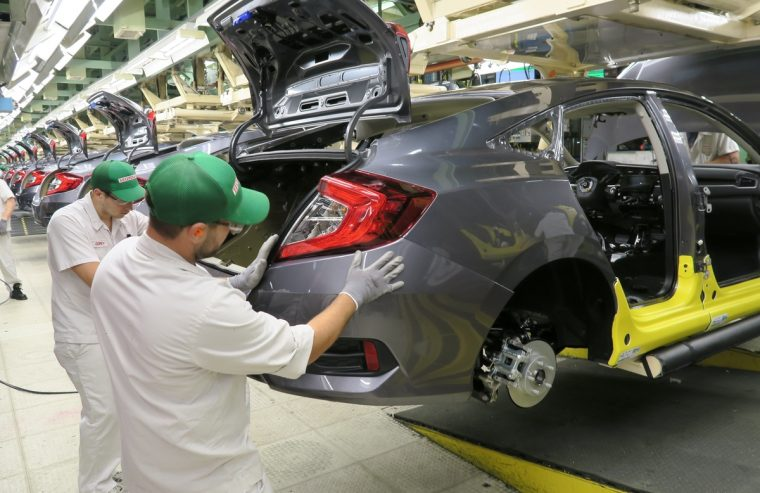 Honda of Canada Mfg. associates install a rear bumper fascia on a 2016 Civic Honda Civic Sedan.