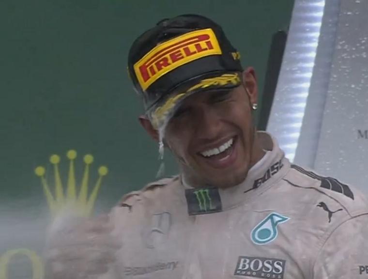 Hamilton sprayed with champagne
