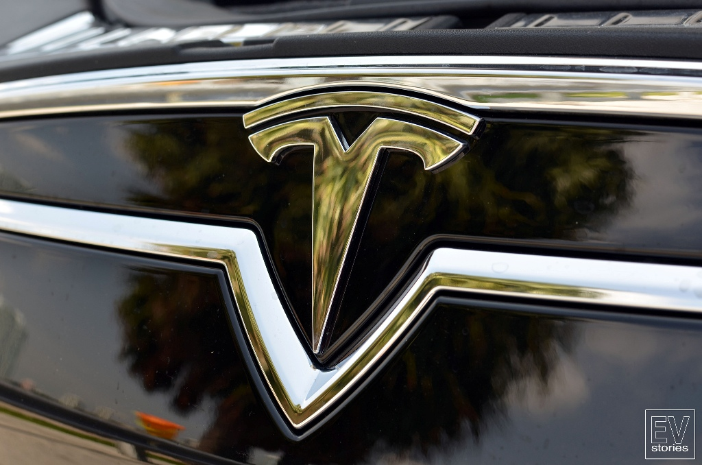 Behind The Badge Does The Tesla Emblem Represent More