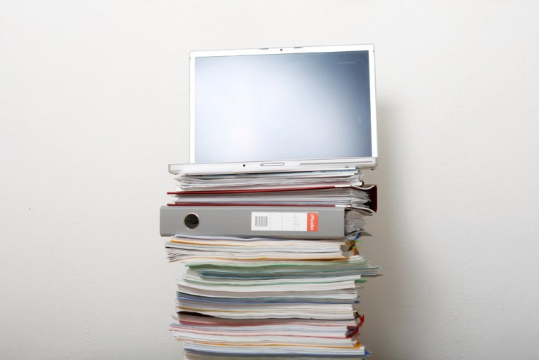 Stack of books and computer