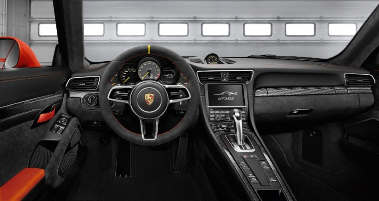 The 2016 Porsche 911 features a 911 logotype badge behind the gearshift lever