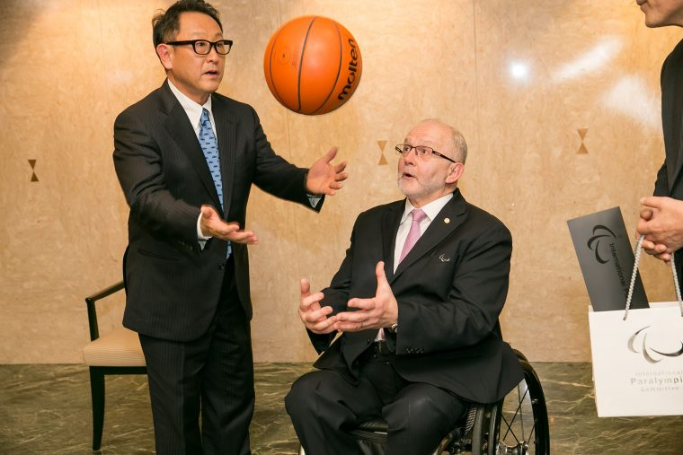 Toyota president Akio Toyoda shoots some hoops with International Paralympic Committee President Sir Philip Craven