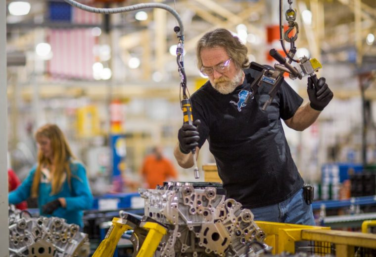 A Flint Engine Operations employee works on a Chevrolet Colorado engine