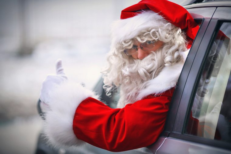Santa driving car instead of reindeer