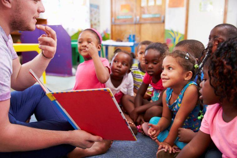 Teacher parent reading to children books