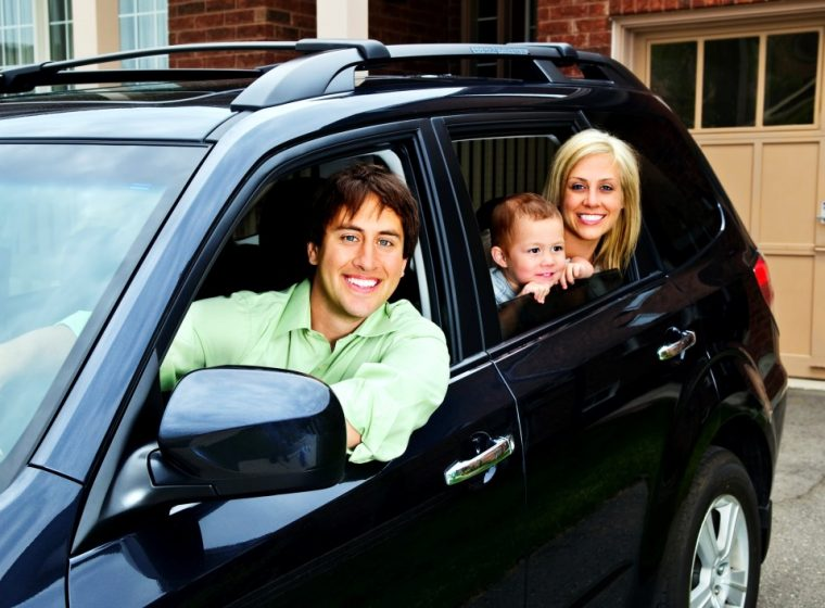 happy family in black car husband wife
