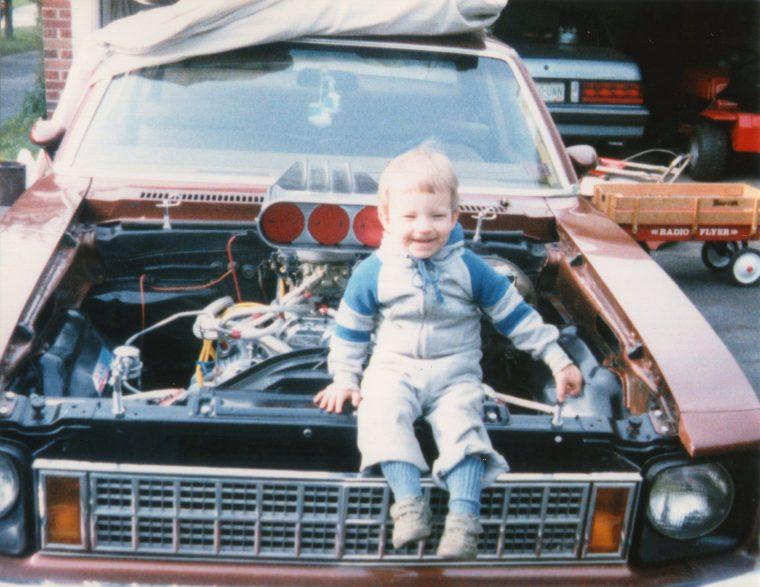 young boy family photo Chevy Nova hood