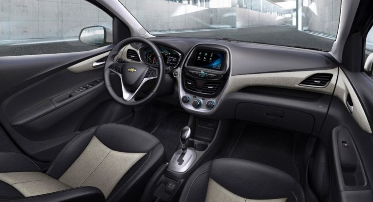 The inside of the 2016 Chevy Spark features a USB port an auxiliary input jack