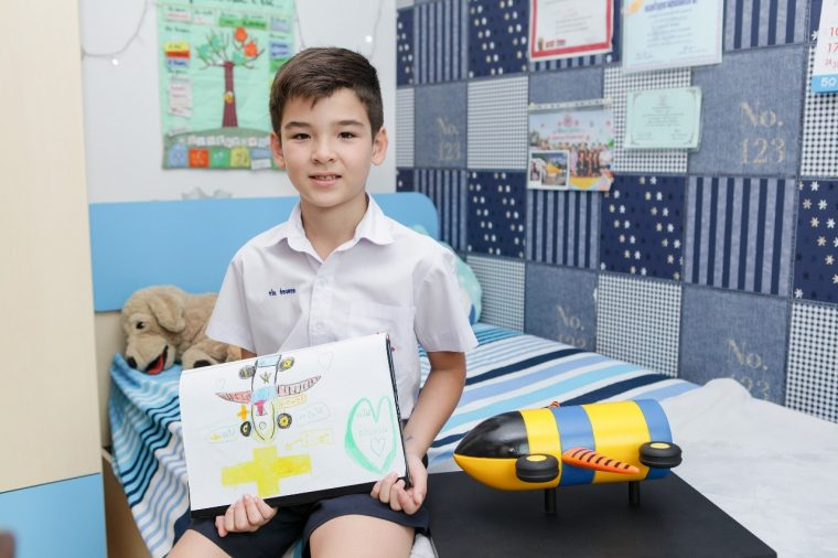 Thai boy poses with winning Chevrolet ultimate dream car drawing