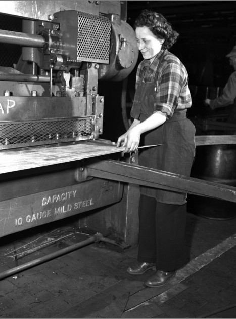A woman working in the tin shop at Willow Run Bomber Plant in 1943