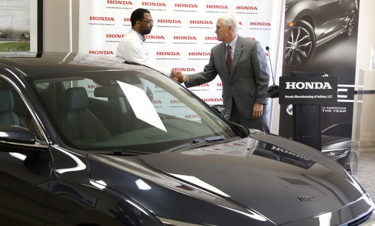 Fred Payne (left), business division manager at Honda Manufacturing of Indiana, greets Indiana Governor Mike Pence at a news conference today announcing a  million investment at the Greensburg plant.