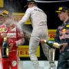 Kvyat sprays Vettel with champagne