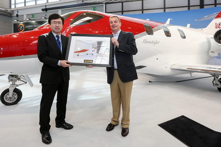 Honda Aircraft Company President and CEO Michimasa Fujino participates in a ceremonial delivery with Johannes Graf von Schaesberg, chairman and CEO of Rheinland Air Service.
