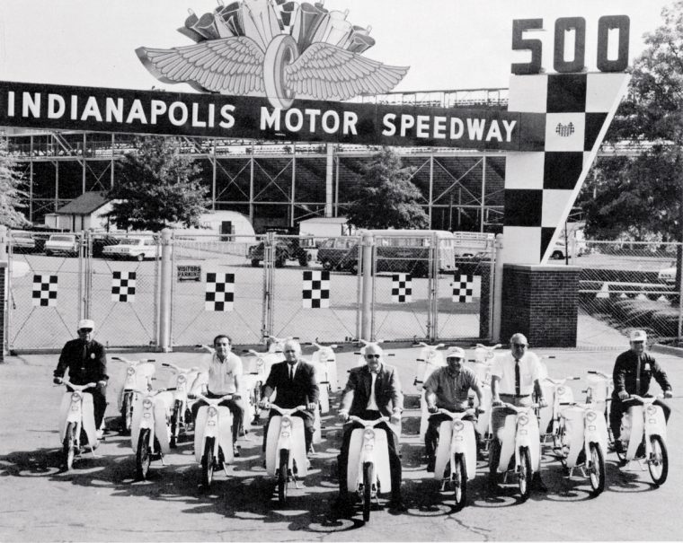 Officials at the 1965 Indy 500 prepared to test ride a fleet of Honda motorcycles