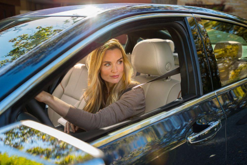 woman driving 2017 Chevrolet Impala LTZ