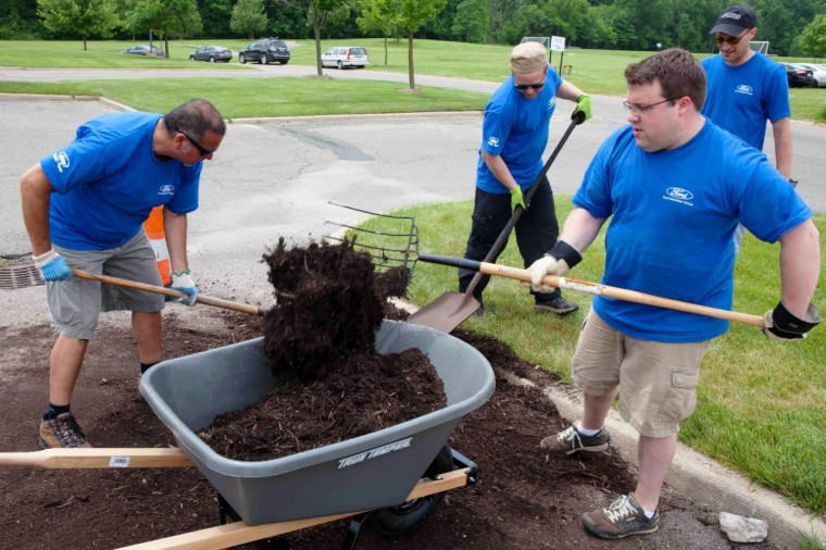 Volunteers at Arbor Hospice in Saline, Michigan help build a native garden on Ford Accelerated Action Day