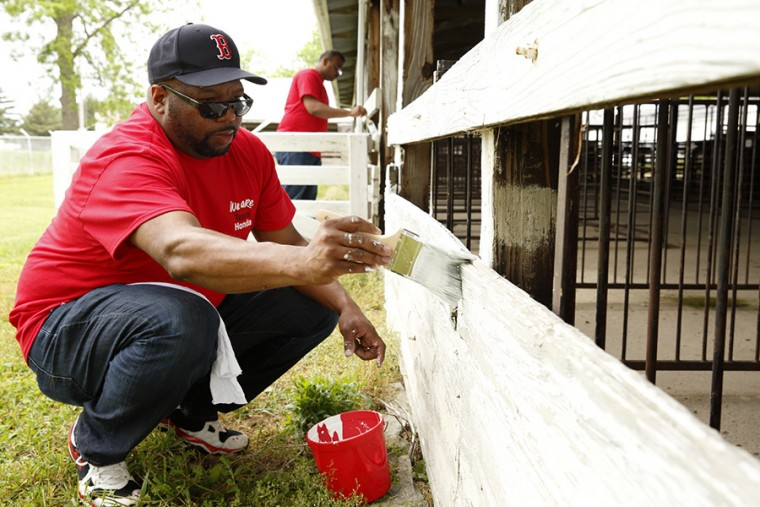 Honda's Pilate Bradley puts a new coat of paint on the sheep barn at the Logan County Fairgrounds in Bellefontaine, Ohio. This activity helped kick off Team Honda's Week of Service, which will run from June 10-19.