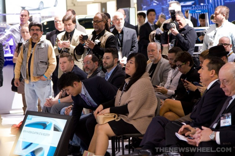 media journalists at press conference at auto show
