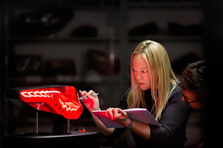 woman designing car tail lights engineering