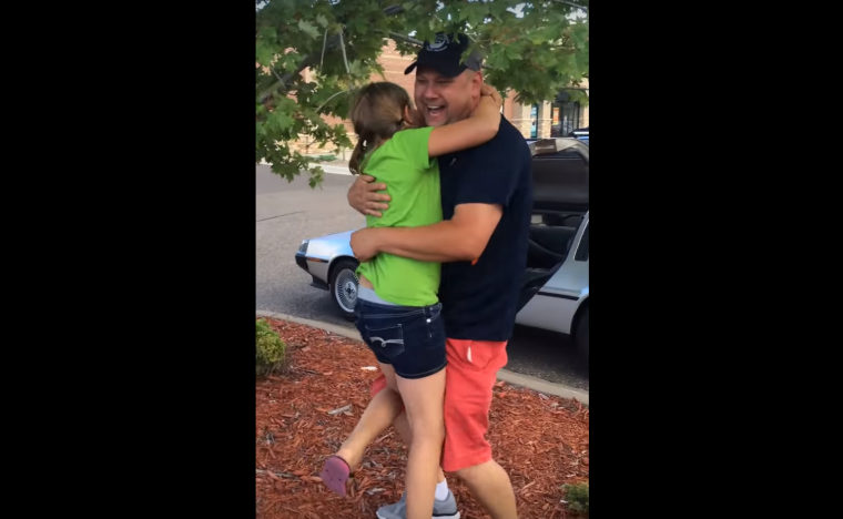 "Girl hugs her dad for buying a DeLorean in ""First time seeing a DeLorean"" video on YouTube"
