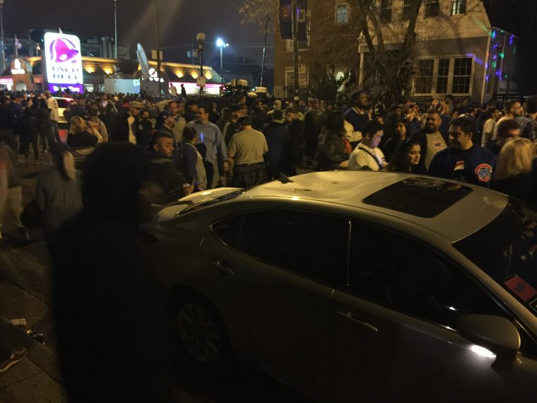 Cubs fans celebrate by wrecking cars near Wrigley Field after Chicago wins World Series