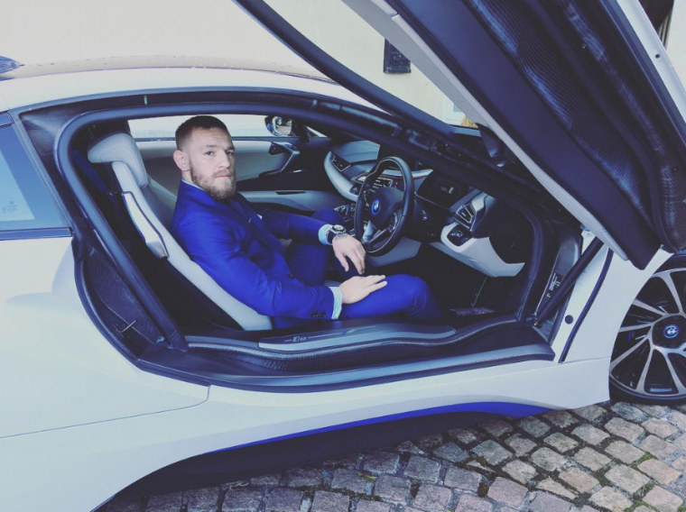 UFC star Conor McGregor has a large car collection, which includes a BMW i8, Cadillac Escalade, Rolls Royce Dawn, Rolls Royce Drophead, and a Lamborghini Aventador