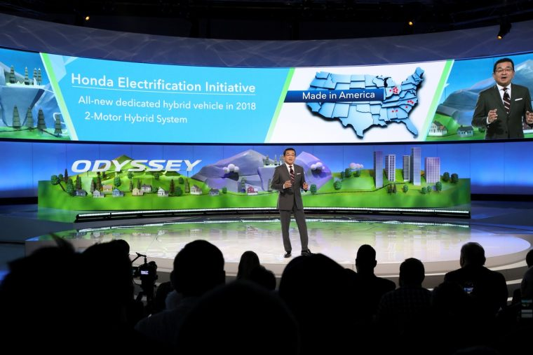 Honda Motor Co. President and CEO Takahiro Hachigo announces Honda's plans to introduce a new dedicated hybrid vehicle in 2018, at the 2017 North American International Auto Show on January 9, 2017