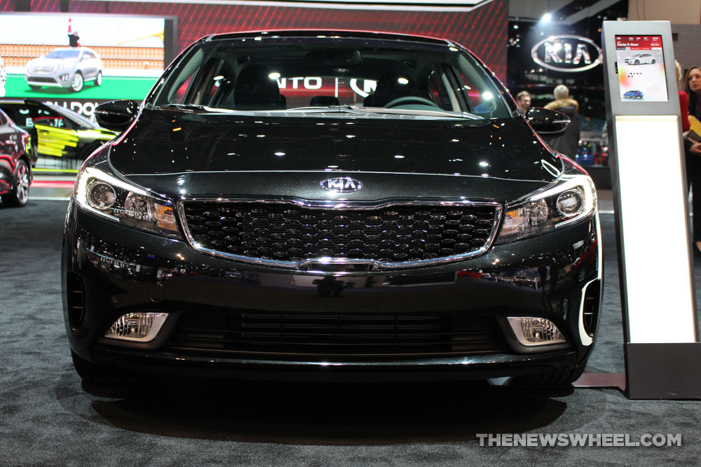 2017 Kia Forte black hatchback car on display Chicago Auto Show