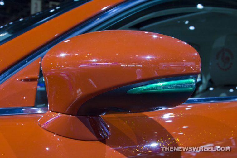 2017 Lexus IS Sriracha orange sedan car on display Chicago Auto Show