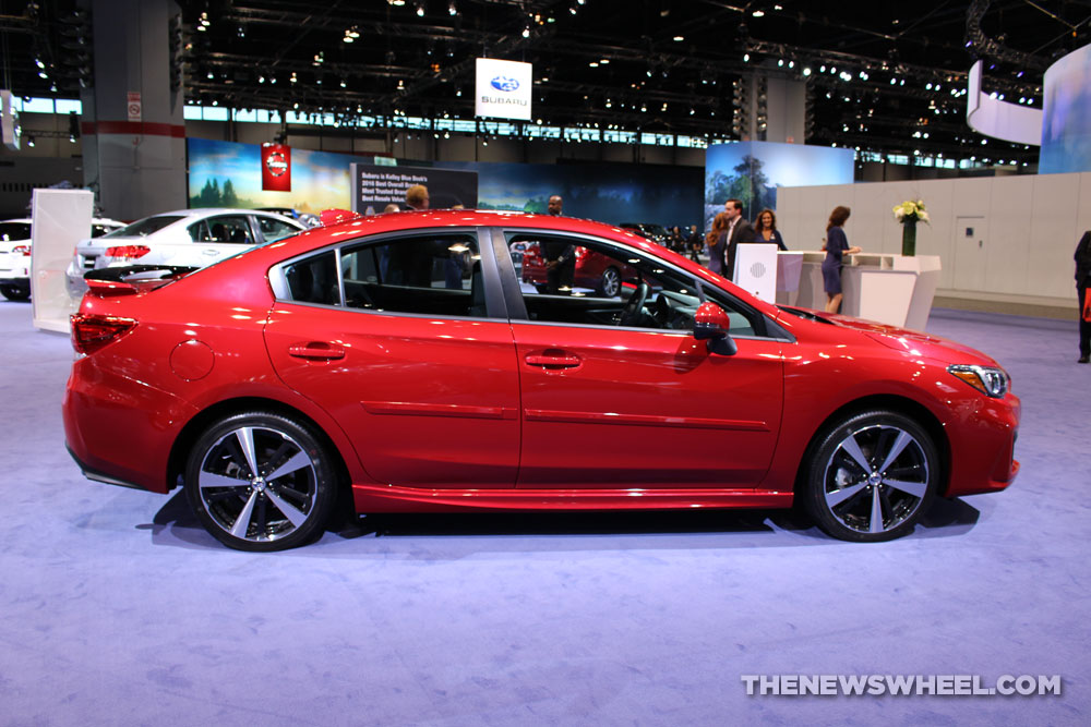 2017 Subaru Impreza 2.0i Sport red sedan car on display Chicago Auto Show